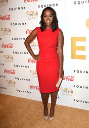 Aja Naomi King opted for a simple red sheath dress when she attended the Gold Meets Golden event.