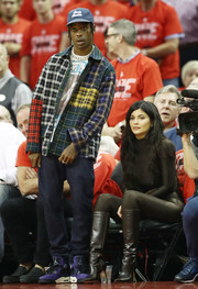 Kylie Jenner vamped it up in brown knee-high boots and a matching catsuit at the 2018 NBA Playoffs.
