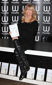 Goldie Hawn wore these ruched black boots at her London book signing.