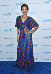 Nicole Richie attended the Love In For Kids event looking sweet in a floral maxi dress with flutter sleeves.