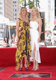 Goldie Hawn looked youthful and flirty in a tiered, handkerchief-hem print dress by Cinq à Sept during her Hollywood Walk of Fame ceremony.