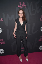 Michelle Dockery teamed her suit with white pumps by Rupert Sanderson.