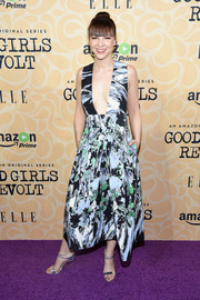 Erin Darke turned heads in a plunging painterly-print dress at the New York screening of 'Good Girls Revolt.'