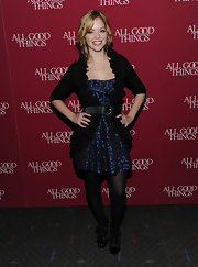 Dreama wers a ruffled black cardigan over a deep blue print cocktail dress at the 'All Good Things' premiere.