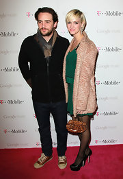 Ashlee Simpson Wentz layered a nubby duster over her mini emerald cocktail dress.