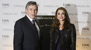 Queen Rania showed her edgier side in the black leather jacket she layered over a purple dress.