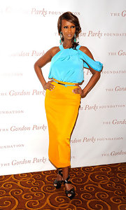 Iman teamed her vibrant colorblock ensemble with black patent platform sandals with crisscrossing straps.