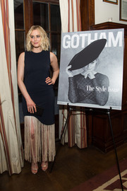 Taylor Schilling chose a sleeveless gown with a fringed hem for the Gotham Magazine VIP dinner.