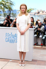 Nicole Kidman looked demure at the 'Grace of Monaco' photocall in a white Altuzarra cocktail dress featuring slashed sleeves and a pleated skirt.