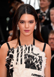 Kendall Jenner went for simple styling with this loose, straight center-parted 'do when she attended the 'Grace of Monaco' premiere.