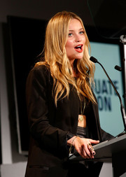 Laura Whitmore accessorized with a full-finger ring at the Graduate Fashion Week George Gold Award.