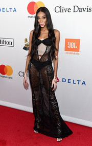 Winnie Harlow brought major sex appeal to the Grammy Salute to Industry Icons with this sheer, plunging lace gown by August Getty Atelier.