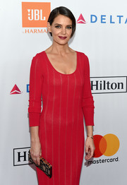 Katie Holmes attended the Grammy Salute to Industry Icons carrying a two-tone beaded clutch.