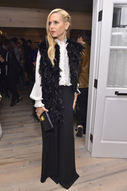 Rachel Zoe finished off her outfit with a funky black feather vest.