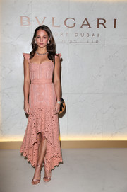 Alicia Vikander looked sweet and sultry at once in a blush-hued Jonathan Simkhai corset dress with ruffle cap sleeves and a high-low hem at the grand opening of Bulgari Dubai Resort.