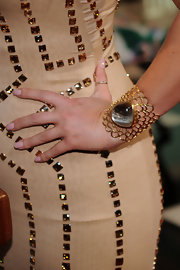 Jessica Simpson showed off an ornate cuff bracelet which was adorned with a unique gemstone.