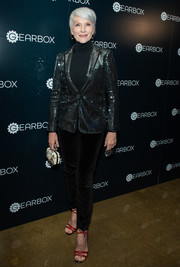 For a splash of color, Maye Musk donned a pair of strappy red heels.