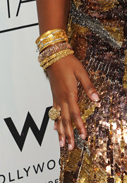 Ashanti showed off some sparkling gold bangles at a recent event in Hollywood. She paired her shining jewels with a gold sequined dress, which highlighted her glowing skin.