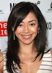 Aimee Garcia attended the LA Farmer's Market wearing her glossy tresses in long layers.