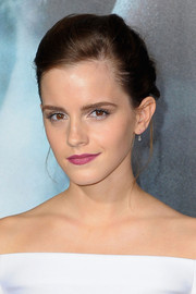Emma Watson's berry lipstick provided a nice pop of color to her white outfit.