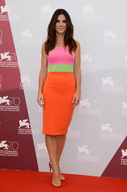 Sandra Bullock does neon the right way with a color-blocked shift dress.