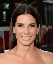 Sandra Bullock achieved a dramatic look with smoky eye makeup during the premiere of 'Gravity.'