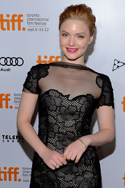 Holliday Grainger looked fresh wearing light makeup featuring popping lined eyes and hot pink lips.