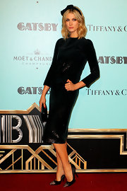 Delta Goodrem showed off her long and lean figure with this sequined black dress.