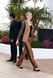 Elizabeth Debicki chose a tan and black pantsuit for her sleek and contemporary look at Cannes Film Festival.