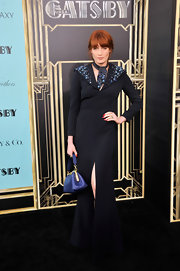 Florence Welch's long navy gown featured an embellished neckline and a front slit.