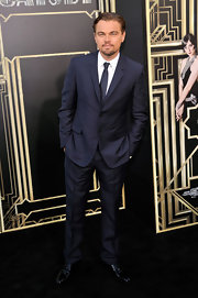 Leonardo DiCaprio looked sleek and dapper in this dark navy, two-button, notch-lapel suit.
