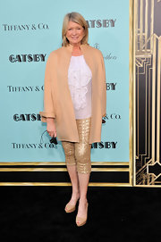 Martha Stewart sported this tan evening coat over a ruffled blouse and gold capris at the red carpet for 'The Great Gatsby.'