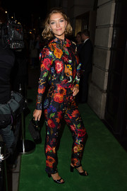 Arizona Muse was all abloom in a long sleeve floral blouse while attending the Green Carpet Challenge BAFTA Night.