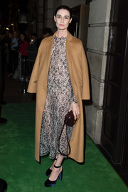 Erin O'Connor was classic in a monochrome lace dress under a camel coat while attending the Green Carpet Challenge BAFTA Night.