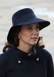 Kate Middleton paired a navy hat with a matching coat for the Grenfell Tower National Memorial Service.