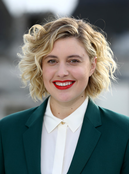 Greta Gerwig Curled Out Bob [little women photocall,hair,face,blond,facial expression,hairstyle,beauty,chin,eyebrow,smile,lady,greta gerwig,little women,releases,cinemas,london,corinthia hotel,uk,little women london,photocall]