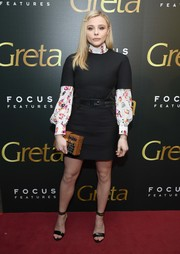Chloe Grace Moretz looked mod in a Louis Vuitton LBD layered over a print blouse at the New York screening of 'Greta.'