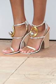 Anais Monory spiced up her plain white frock with this silver and gold pair of summery sandals.
