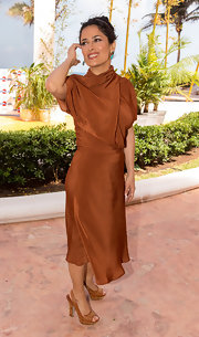Salma Hayek stunned in a copper day dress while out promoting 'Grown Ups 2' in Mexico.