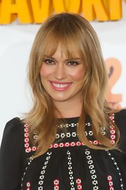 Patricia's blonde locks looked retro chic with this wavy shag with bangs.