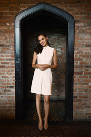 Gal Gadot looked impeccable in a sleeveless white Gucci dress during the brand's Bamboo fragrance launch.