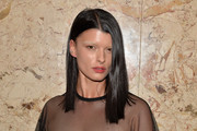 Crystal Renn sported a straight hairstyle with an off-center part at the Gucci beauty launch event.