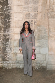 Salma Hayek went retro in a patterned gray pantsuit with pink trim for the Gucci Cruise 2019 show.