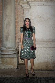 Salma Hayek paired her dress with bowed T-strap platforms.