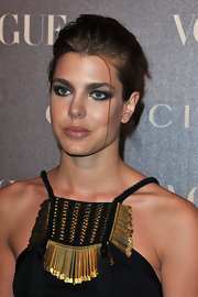 Charlotte took to a bolder beauty look at the Vogue bash in Paris, opting for a dramatic smoky eye.