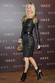 Poppy Delevigne donned dramatic black cut out ankle boots to the Vogue Paris dinner.