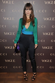 Olivia was avant-garde in a color block silk harem jumpsuit for the Gucci Rue Royale Reopening party.