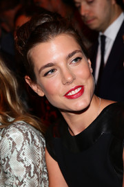 Charlotte Casiraghi perked up her beauty look with a swipe of vibrant red lipstick.