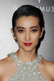 Li Bingbing wore a cool, classic red lipstick to the Gucci Museum opening. To recreate Li's chic look, try a full-coverage, moisturizing lipstick in a red shade with a cool undertone. A great option is Covergirl LipPerfection Lipcolor in Tempt.