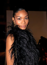 Chanel Iman balanced the drama of her feathered dress with neutral eyeshadow and full lashes.